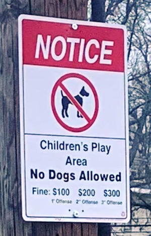 """Swampscott Department of Public Works installed """"no dogs allowed"""" signs at several public parks, playing fields and open spaces across town."""