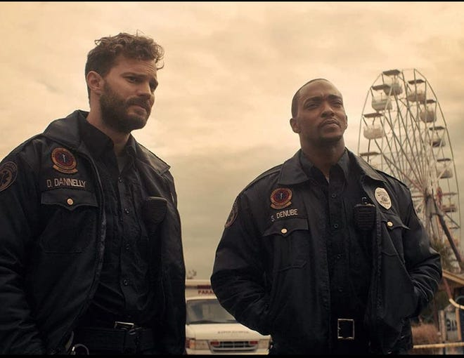 """Anthony Mackie, right, and Jamie Dornan star in """"Synchronic."""""""