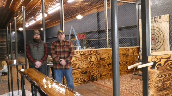 Steve Knapp and Shawn Miller, from left, will offer recreational axe-throwing at The Copper Irons, 215 S. Sandusky Ave., starting this week.