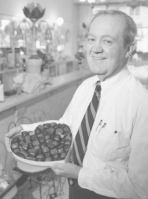 Jan. 31, 1997: Jim Aglamesis of Aglamesis Brothers on Oakley Square with a box of his hand-made chocolates.
