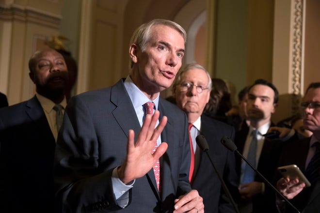 Sen. Rob Portman, R-Ohio, a member of the Senate Finance Committee, joins Sen. Tim Scott, R-S.C., left, and Majority Leader Mitch McConnell, R-Ky., to talk about work on overhauling the nation's tax code, on Capitol Hill in Washington, Tuesday, Nov. 14, 2017.