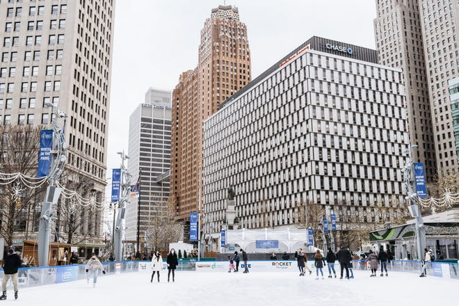 Guests skate on The Rink at Campus Martius Park.