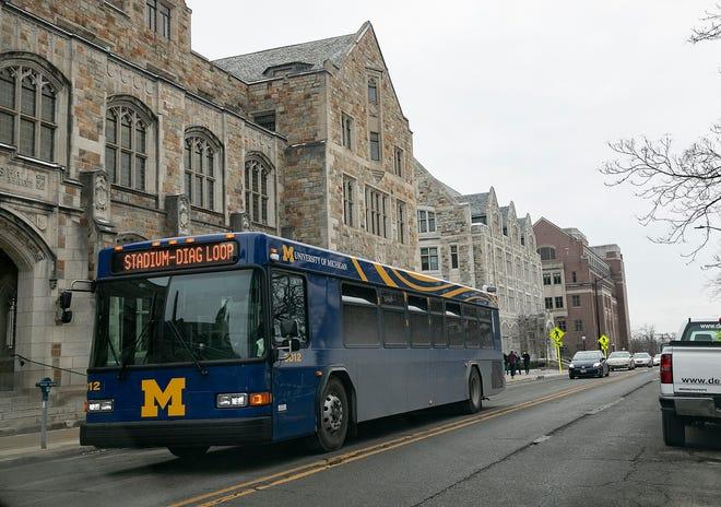A University of Michigan bus makes its way around campus Monday, Jan. 25, 2021.