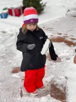 The SnowOtter Stowsuit seen on 4-year-old Piper Bailey from Chicago includes detachable mittens and snow pants that extend to grow with your child.