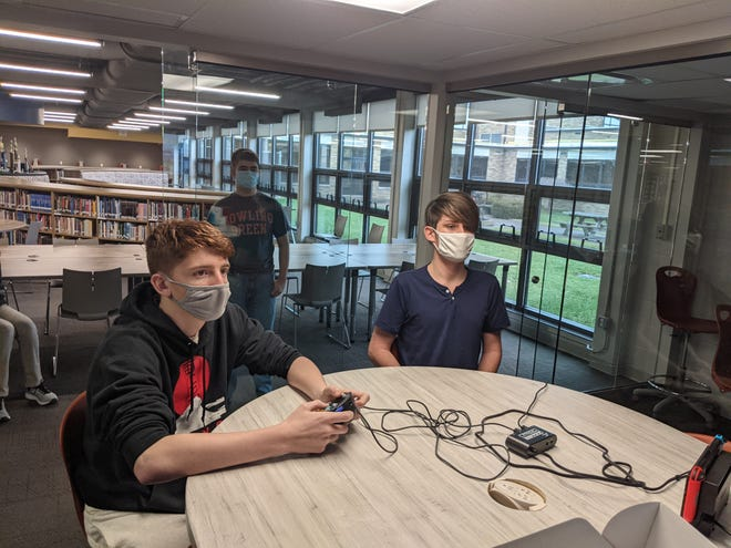 E-Sports practice at Port Clinton High School. Left to right are  Seth Haynes, Landon Staib, Captain, and Tyler Rodrigue-Hejhal.