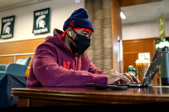 Michigan State University senior Tracy Markray, a physiology major from Ann Arbor, studies in the MSU Union on Monday, Jan. 25, 2021, in East Lansing.