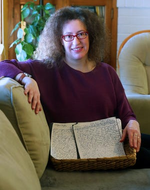 """Lauren Fox of Shorewood sits with copies of letters her Jewish great-grandmother wrote from Germany to her daughter who left to escape the Holocaust. Fox incorporates parts of the letters in her new novel """"Send for Me."""""""