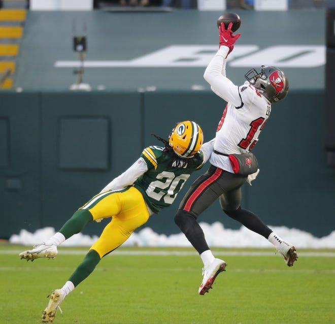 Green Bay Packers cornerback Kevin King (20) breaks up a pass intended for Tampa Bay Buccaneers wide receiver Mike Evans (13) during the fourth quarter of their NFC championship game Sunday, January 24, 2021 at Lambeau Field in Green Bay, Wis. The Tampa Bay Buccaneers beat the Green Bay Packers 31-26.