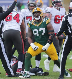 Green Bay Packers defensive tackle Kenny Clark celebrated a sack of Tom Brady during last season's NFC title game.