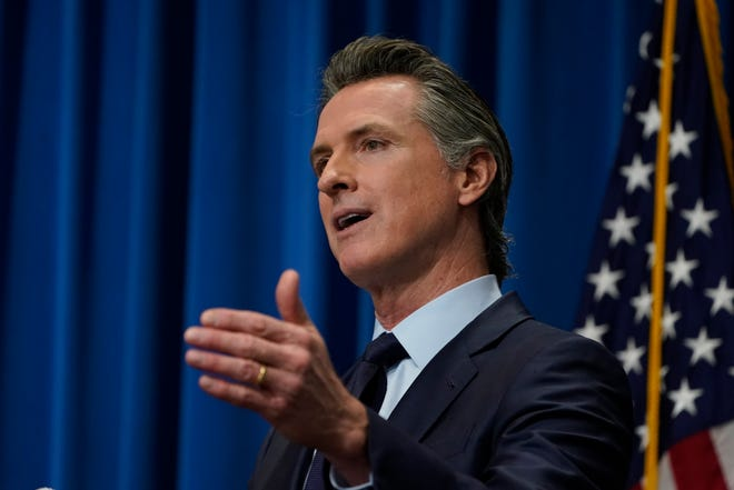 California Gov. Gavin Newsom outlines his 2021-2022 state budget proposal during a news conference in Sacramento on Jan. 8, 2021.
