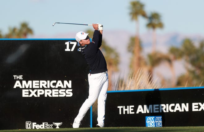 Si Woo Kim tees off on the 17th hole at the Stadium Course during the American Express at PGA West in La Quinta, Calif. on Sunday, January 24, 2021.