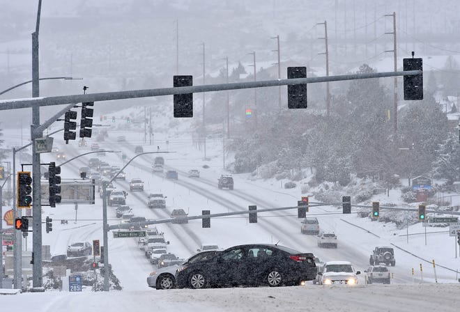 Traffic moves slowly on North McCarran after a snow stomr Monday morning Jan. 25, 2021