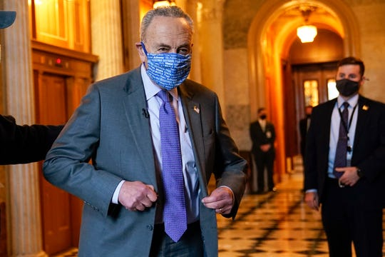 Senate Majority Leader Chuck Schumer of N.Y., heads to an interview on Capitol Hill in Washington, Monday, Jan. 25, 2021.