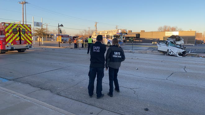 Crime Scene Investigators arrive at a multi-vehicle crash at East 19th and North Chadbourne Streets on Monday, Jan. 25, 2021.