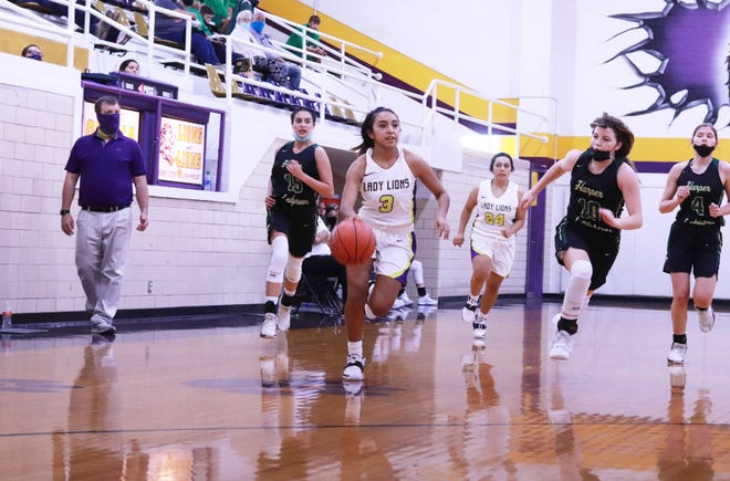 Ozona High School's Dorisel Sanchez pushes the ball up the court while Ozona head coach Chad Myers watches during a game against Harper Nov. 23, 2020, in the Ozona gym.