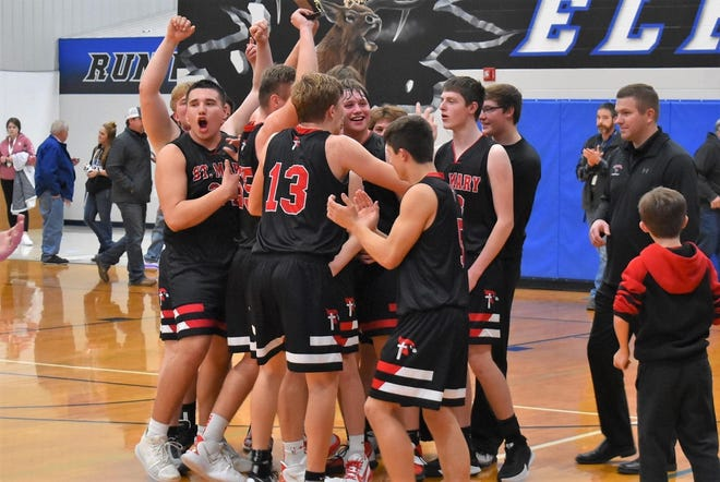 St. Mary players celebrate their second straight Dakota Valley Conference tournament championship on Saturday, Jan. 23, 2020 in Elkton.