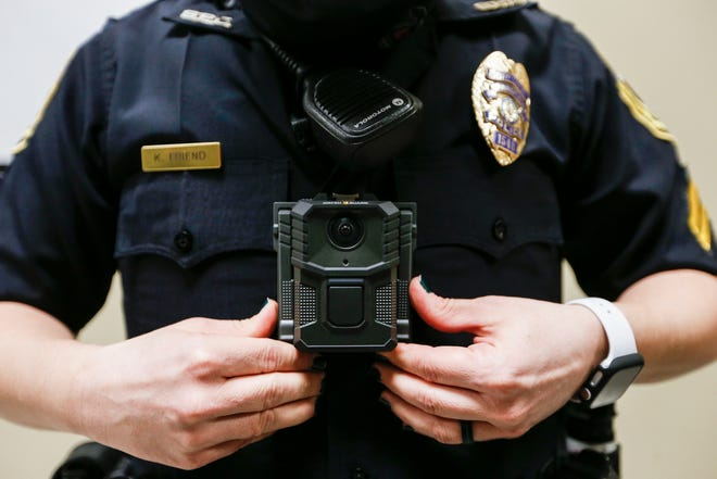 Springfield Police Corporal Kaylee Friend demonstrates how to put on the department's new body cameras on Monday, Jan. 25, 2021.
