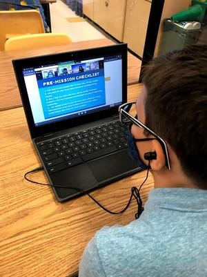 An FSUS fifth-grader prepares for the Europa Encounter virtual mission.