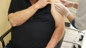 Russell Oxer, 78, of Port St. Lucie, Fla., receives the Moderna COVID-19 vaccine at a Publix pharmacy in Palm City, Monday, Jan. 25, 2021.