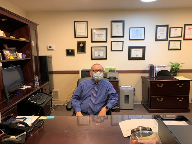 Superintendent Tony Rodriguez sits in his office at the Tulare Joint Union High School District headquarters on Jan. 21, 2021.