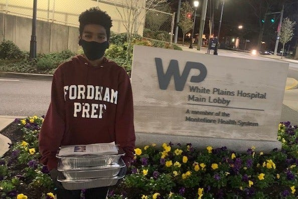 Fordham Prep junior Shane Daughtry with food donations he acquired and gave out to frontline workers.