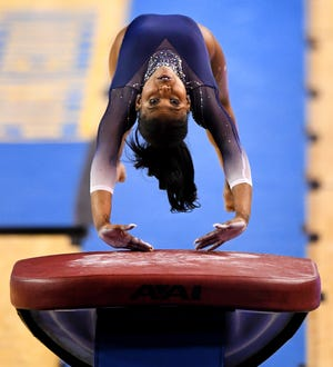 UCLA gymnast Nia Dennis competes in the vault against Arizona State.