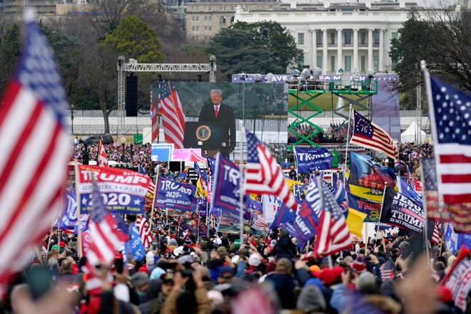 Then-President Donald Trump talks to supporters during the Jan. 6 rally that preceded the violent attack on the U.S. Capitol. Trump told the thousands in attendance to march straight to the Capitol building.
