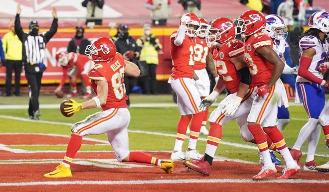 Kansas City Chiefs tight end Travis Kelce celebrates after scoring a touchdown against the Buffalo Bills.