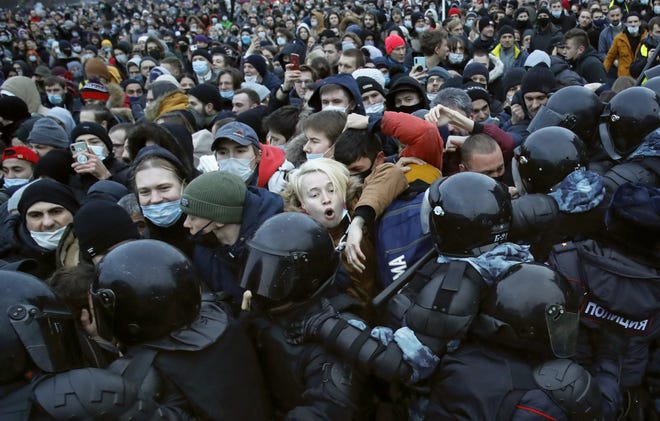 People clash with police during a protest against the jailing of opposition leader Alexei Navalny in St. Petersburg, Russia on Jan. 23. [AP Photo/Dmitri Lovetsky, File]