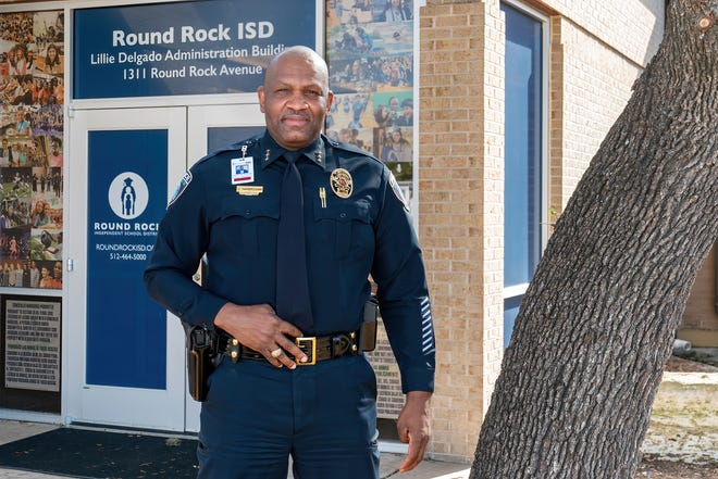 Round Rock school district Police Chief Jeffrey Yarbrough poses outside Round Rock High School. The district opted to form its own police department rather than maintain contracts with local law enforcement. The Lake Travis school district is also forming its own police department.