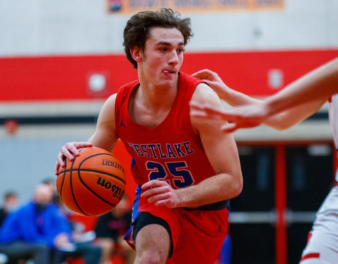 Westlake's Eain Mowat, driving to the basket in a win over Bowie last week, set a school record for most wins by a Westlake player earlier this month. The three-year starter at point guard has helped the Chaps to a lofty state ranking and a perfect record in District 26-6A.