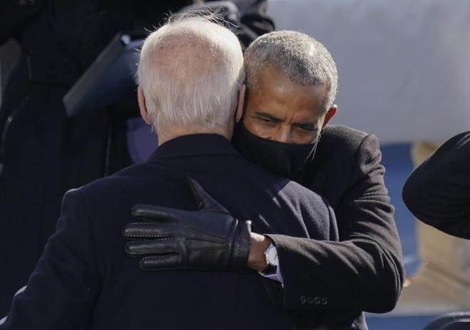 Former President Barack Obama embraces President Joe Biden at his inauguration on Jan. 20. During the Obama years, there was an unspoken insistence that the role of the left was to uplift the president rather than to task him, Charles M. Blow writes.  [AP Photo/Carolyn Kaster)