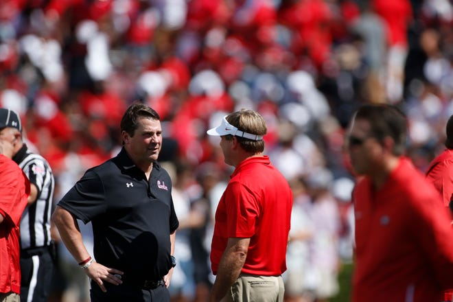 South Carolina coach Will Muschamp speaks with Georgia coach Kirby Smart before the start of a game between Georgia and South Carolina at Williams-Brice Stadium, Saturday, Sep 8, 2018.