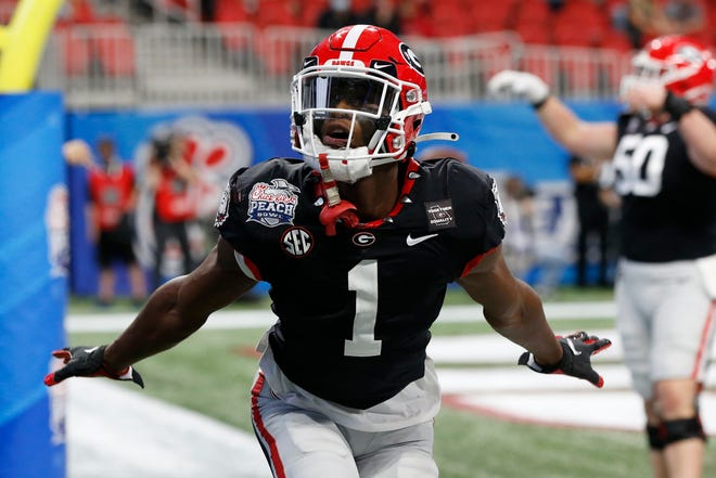 Jan 1, 2021; Atlanta, GA, USA; Georgia wide receiver George Pickens (1) celebrates after scoring a touchdown during the first half of the Peach Bowl NCAA college football game between Georgia and Cincinnati at Mercedes-Benz Stadium in Atlanta., on Saturday, Jan. 1, 2021. Joshua L. Jones-USA TODAY NETWORK/Athens Banner-Herald