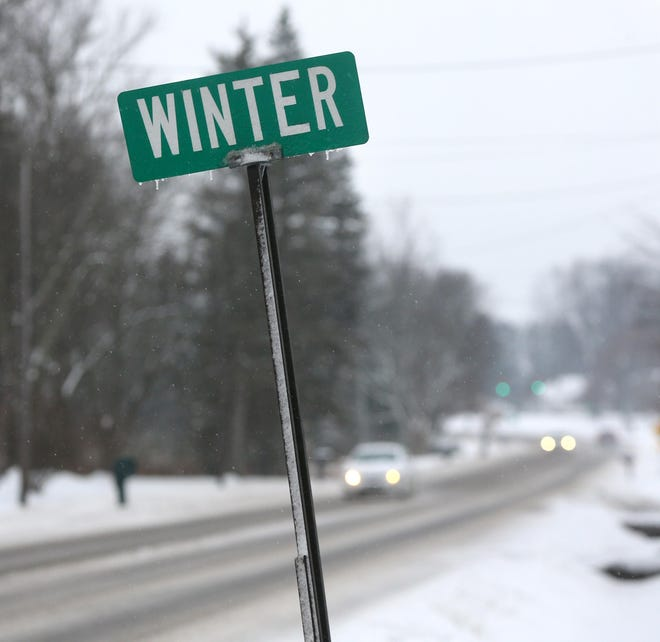 Drivers navigate state Route 44 in Nimishillen Township as a winter storm moved through the region in this file photo.