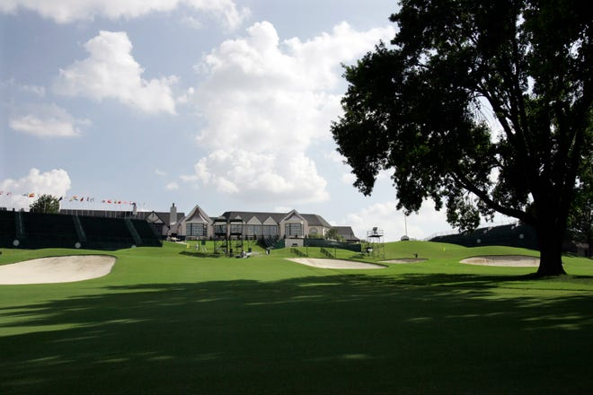 In this Aug. 5, 2007, file photo, the 18th fairway with the Southern Hills Country Club clubhouse visible is viewed at the 89th PGA Golf Championship in Tulsa, Okla. The 2022 PGA Championship, originally scheduled for Trump National in New Jersey, will be played at Southern Hills. (AP Photo/Rob Carr, File)