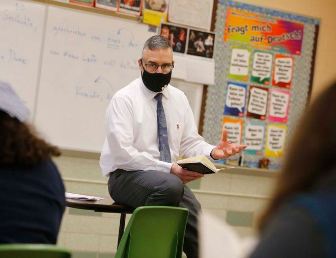 Endre Szentkiralyi teaches a German language class Tuesday at Nordonia High School. The district is working with Summit County Public Health to vaccinate teachers when possible.