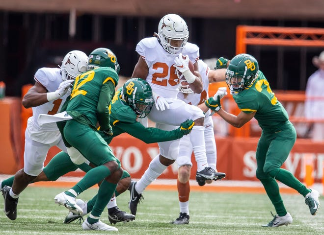 Texas running back Keaontay Ingram (26) fights for yardage during a game against Baylor on Oct. 24, 2020 in Austin. Ingram will transfer to USC.