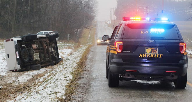 This gold Chevy Silverado went off the left side of County Road 1754 on Tuesday.  Freezing precipitation overnight caused a lot of the Ashland County roads to be icy. TONY ORENDER, TIMES-GAZETTE.COM