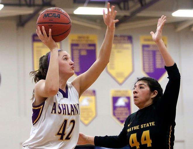 Ashland University's Annie Roshak (42) shoots over Wayne State's Tori Perez (44) during women's college basketball action Tuesday at Kates Gymnasium. The Eagles won, 83-66.
