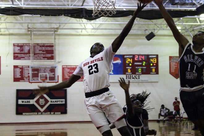 Jamian Risher (23) goes up for a layup for WHHS.
