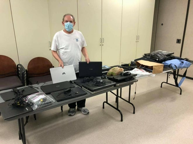 Cherry Hill man Marc Goldstein collects computers during a donation drive at the Burlington County Library on Jan. 9.