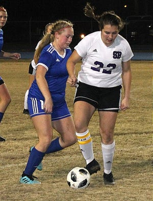 SBHS senior Jenna Mullican (22), seen here against DeRidder, scored four goals and had seven assists as the Lady K's won three straight matches on Friday and Saturday by a combined score of 23-1.