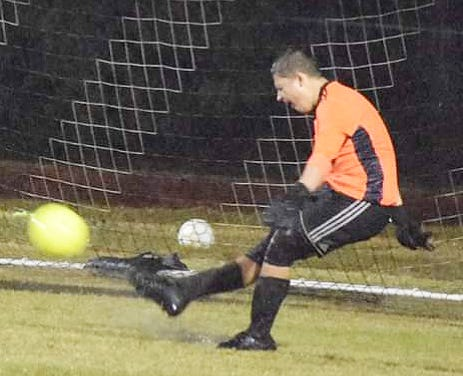 Leesville junior Caden Catron steps into the goal kick during a recent win over Grant. Catron had eight saves on Monday in a shutout win over DeRidder. It was Catron's fifth straight shutout.