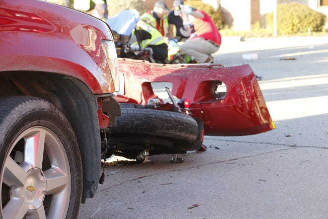 First responders treat an injured motorcyclist after his motorcycle and a Chevrolet Suburban SUV collided in the 1200 block of Austin Avenue in Brownwood Monday afternoon.