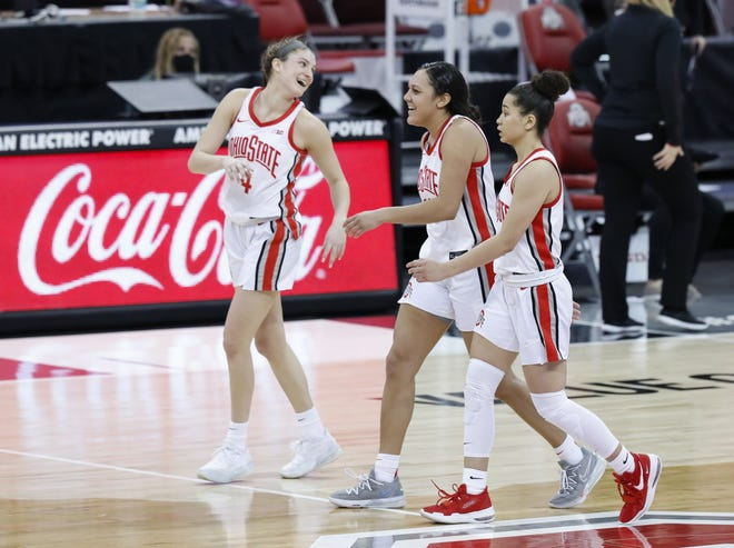 Ohio State guards, from left, Jacy Sheldon, Braxtin Miller and Madison Greene share a moment of happiness and relief as they walk off the court after the Buckeyes' victory against Maryland on Monday.
