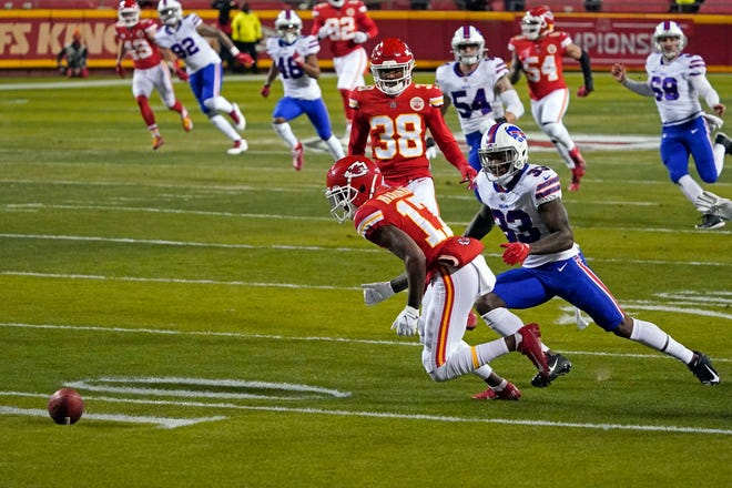Kansas City Chiefs wide receiver Mecole Hardman fumbles a punt in front of Buffalo Bills cornerback Siran Neal during the first half of the AFC championship game Sunday.