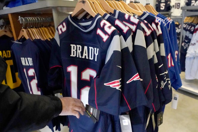 A person browses for Tom Brady jerseys in the pro shop at Gillette Stadium on Monday. Brady is going to the Super Bowl for the 10th time, and Patriots fans are cheering for him.