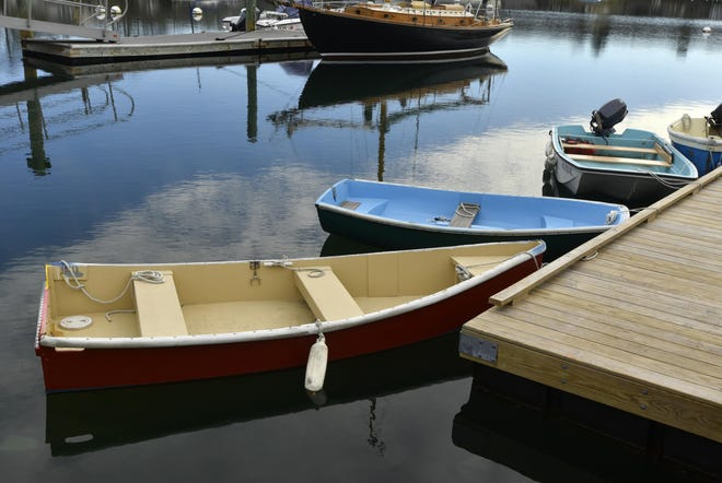 Woods Hole Jan. 26, 2021. All calm on Eel Pond as boats color up the winter grayness.