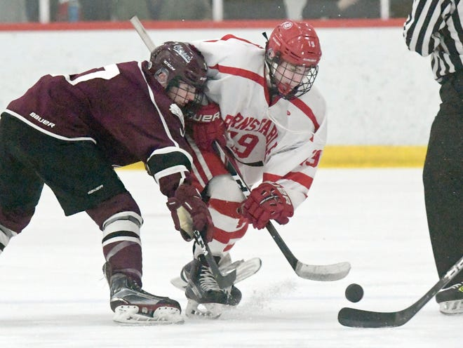 Jack Scipione of Barnstable and Eric Wainwright of  Falmouth go after the puck during a game last year.